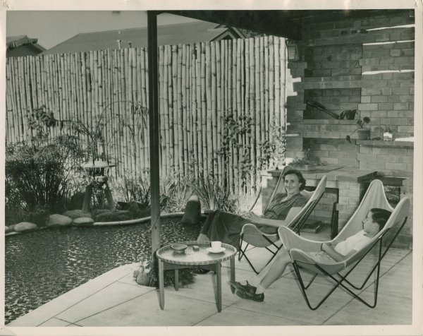 Black and white photograph of Karl and Gertrude Langer sitting in a garden overlooking a pond.