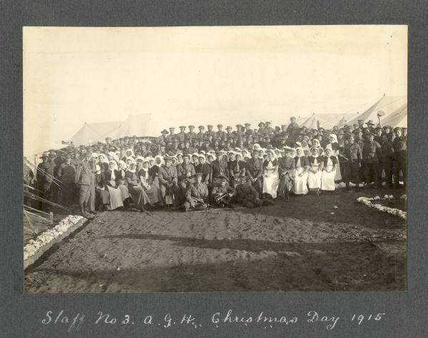 Photograph of group of men and women in military and medical uniforms captioned 'Staff no 3. A.G.H. Christmas Day 1915'