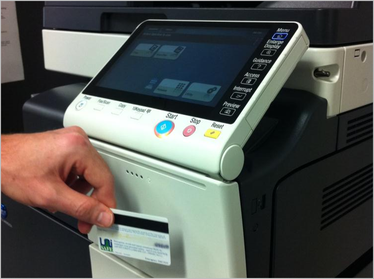 The card scanner is just below the printer touch screen.