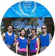 Library staff standing under a banner at UQ's Great Race