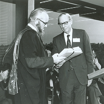 Derek Fielding, University Librarian, receiving Dick Roughsey's papers from Len Fisher at opening of Central Library, University of Queensland, Brisbane