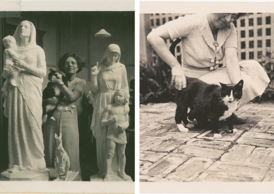 Daphne Mayo in her studio, standing in between two scupltures of saints holding her cat and Daphne Mayo patting a cat