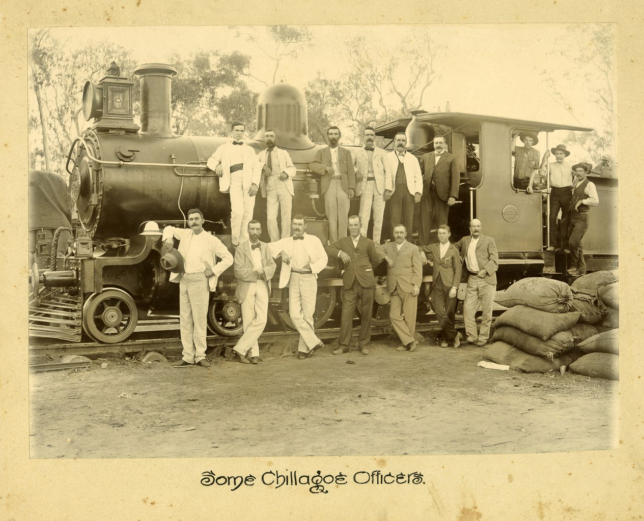 Image of Chillagoe officers standing in front and on locamotive.