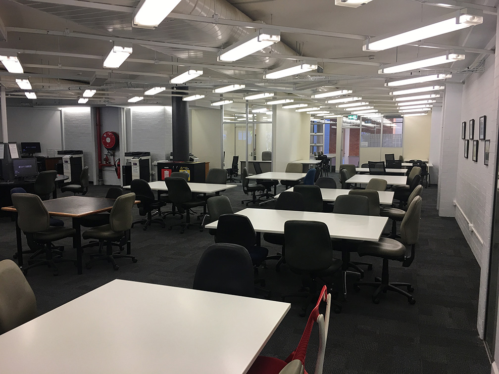 Renovated Level 2 Study space with tables, chairs and Library printers.