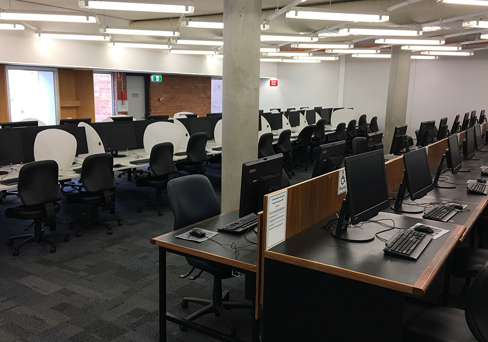 Study spaces with library computers, level 3, Dorothy Hill Engineering and Sciences Library.