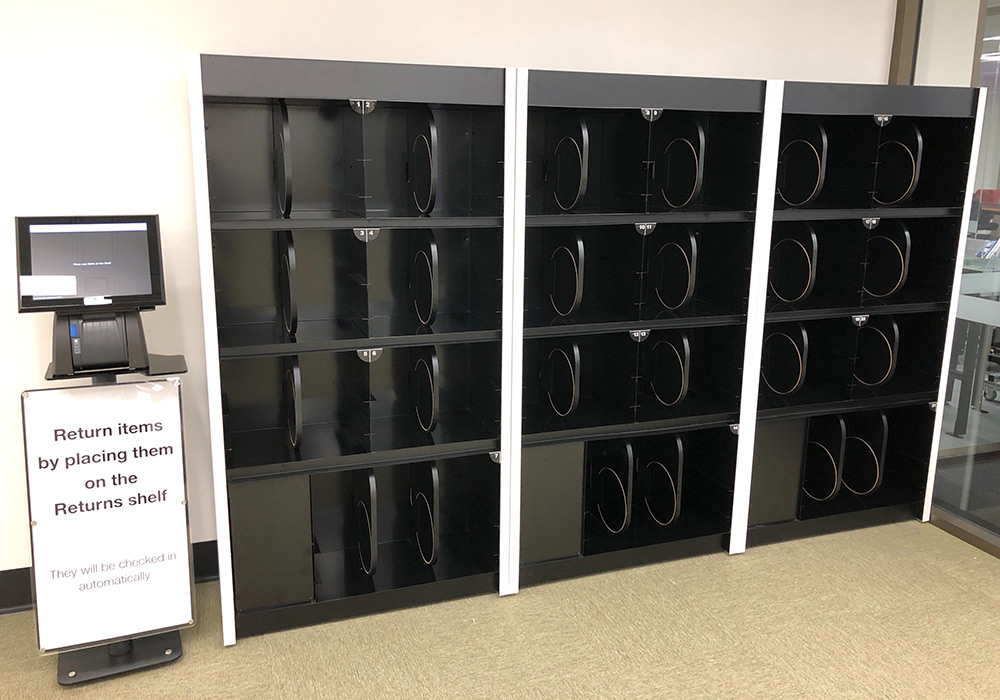 Automatic return shelves for High-Use Items, level one, Central Library.