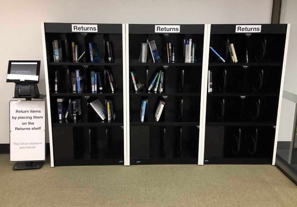 High-use return shelfs. Caption below