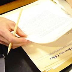 Photo of researcher working with Fryer Library materials