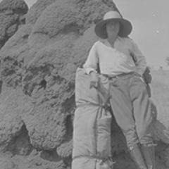 Ernestine Hill with swag, leaning against large ant hill