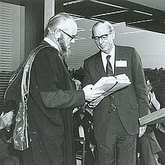 Former University Librarian, Derek Fielding, receiving Dick Roughsey's papers from Len Fisher at opening of Central Library, The University of Queensland, Brisbane