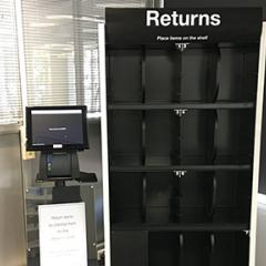 Automatic return shelf and adjacent display screen.